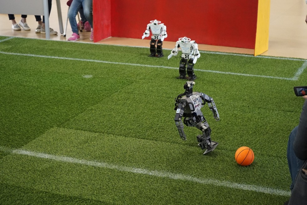 Robot football match held between two Kazan University teams to celebrate FIFA World Cup ,HSITIS, IE, robotics, footbal, FIFA World Cup